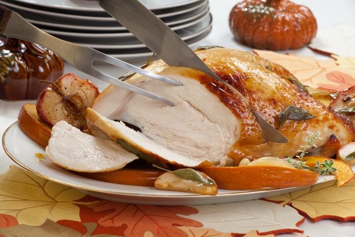 honey butter rub turkey breast garnished with roasted pumpkin
