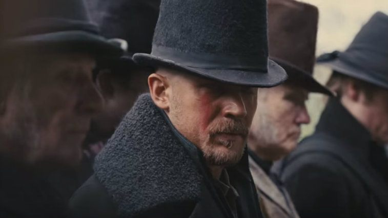Tom Hardy stands in a group of men in FX's Taboo