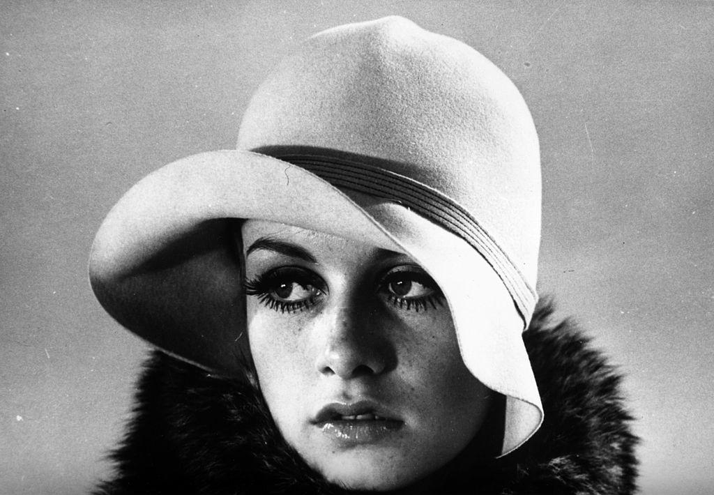 British fashion model Twiggy (born Lesley Hornby) modeling a felt cloche hat