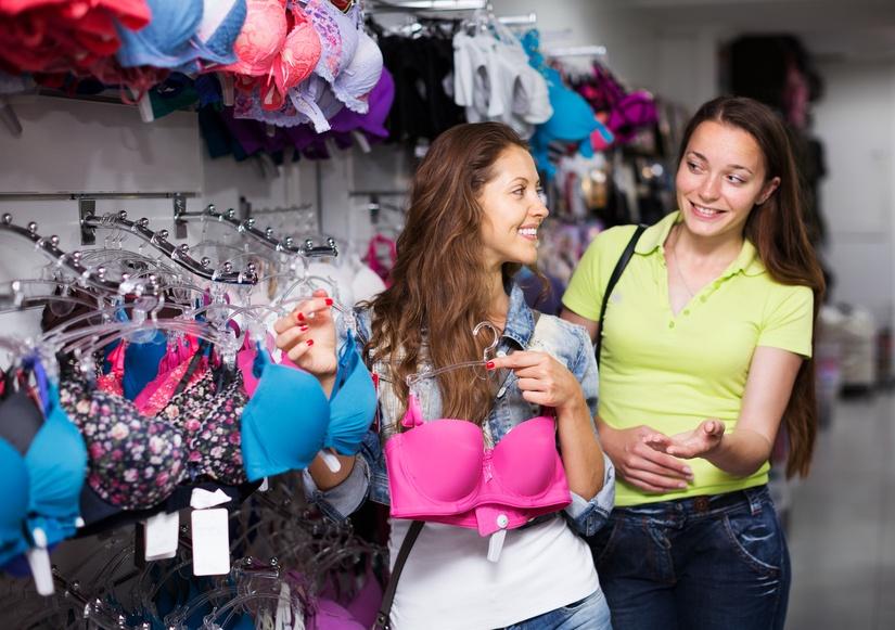 Two smiling women choosing underwear