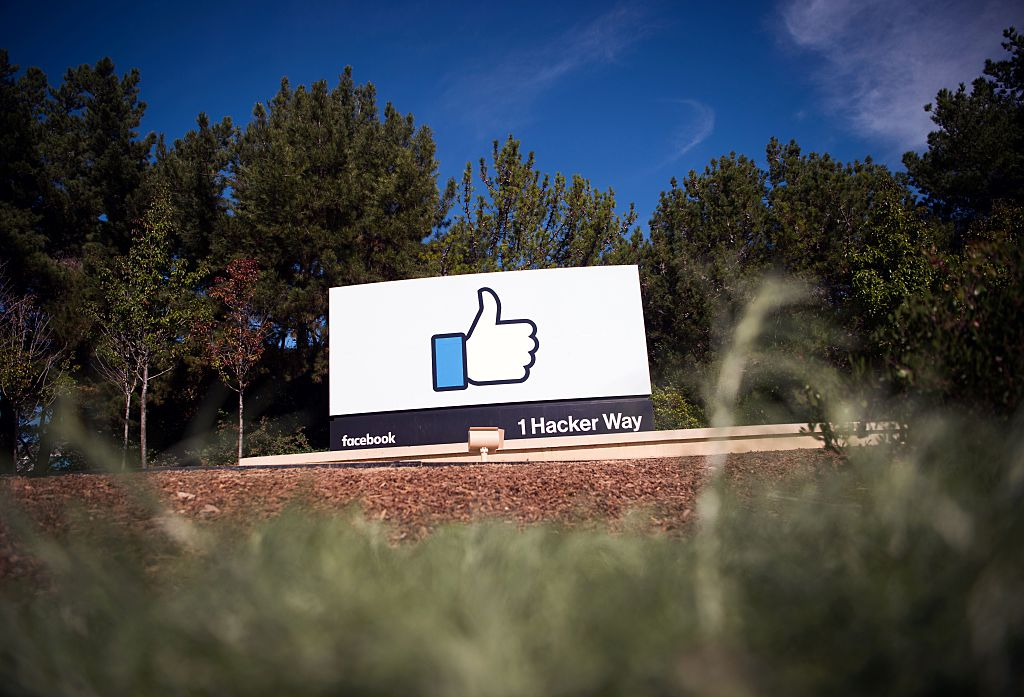 The Facebook sign and logo is seen in Menlo Park, California