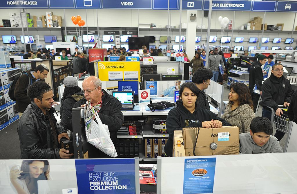 Shoppers look at laptop computers inside a Best Buy store