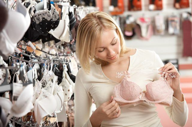woman considers a brassiere