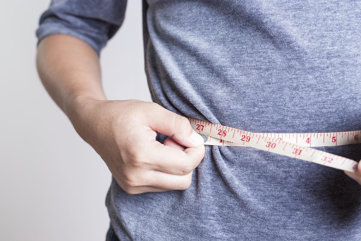Woman checking her waistline