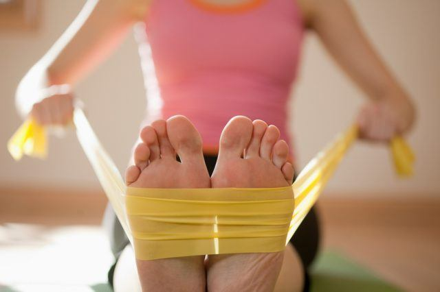 Woman exercises with resistance bands