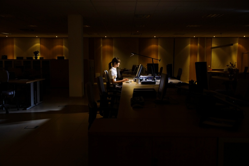 young woman working on computer late at night