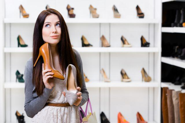 Woman keeps two stylish pumps in the shopping mall