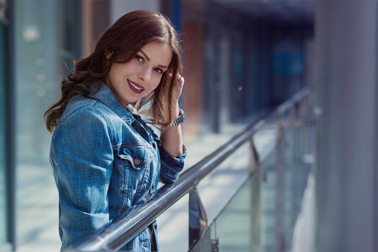 stylish woman walking in a shopping mall