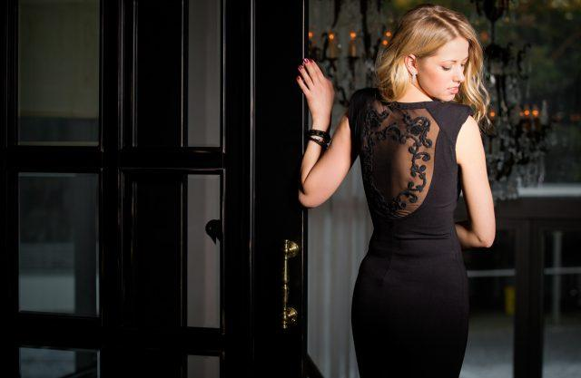Lady in a black dress with a lace back