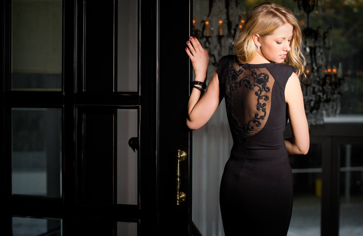 Lady in black dress with lace back
