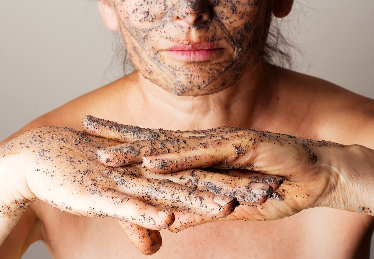 Mature woman making cosmetic mask from coffee