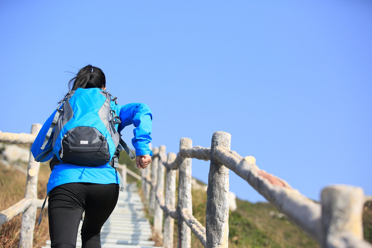woman climbing mountain staris