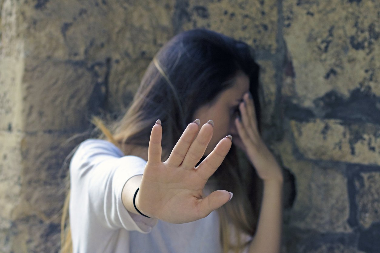 Stop gesture by a woman