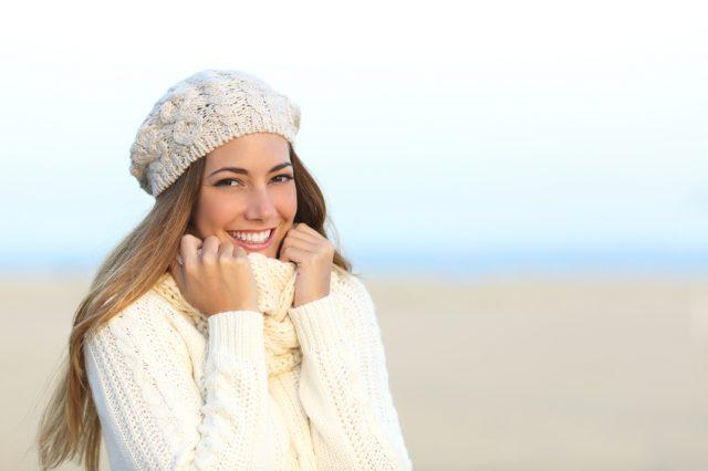 Woman wearing a warm sweater in a cold winter