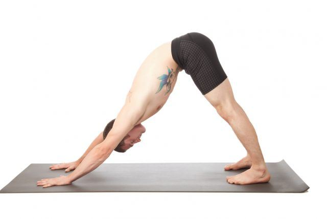 Man doing the downward facing dog position