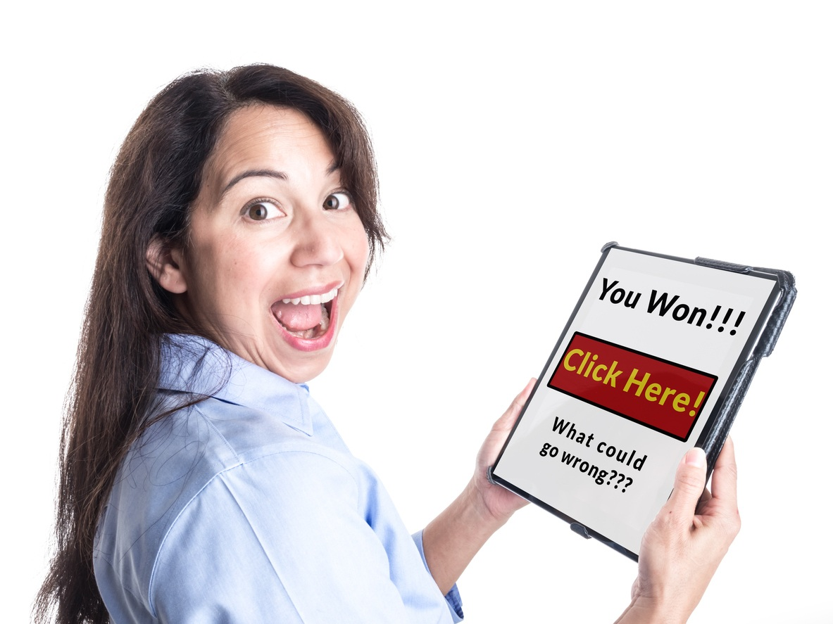 "smiling woman holding a tablet that says ""You won!!! Click here! What could go wrong???"""