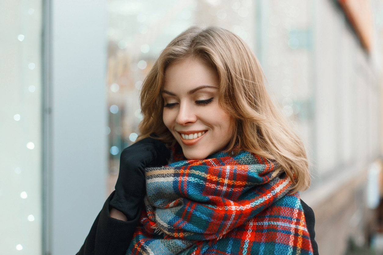 Young beautiful girl with a smile in vintage scarf