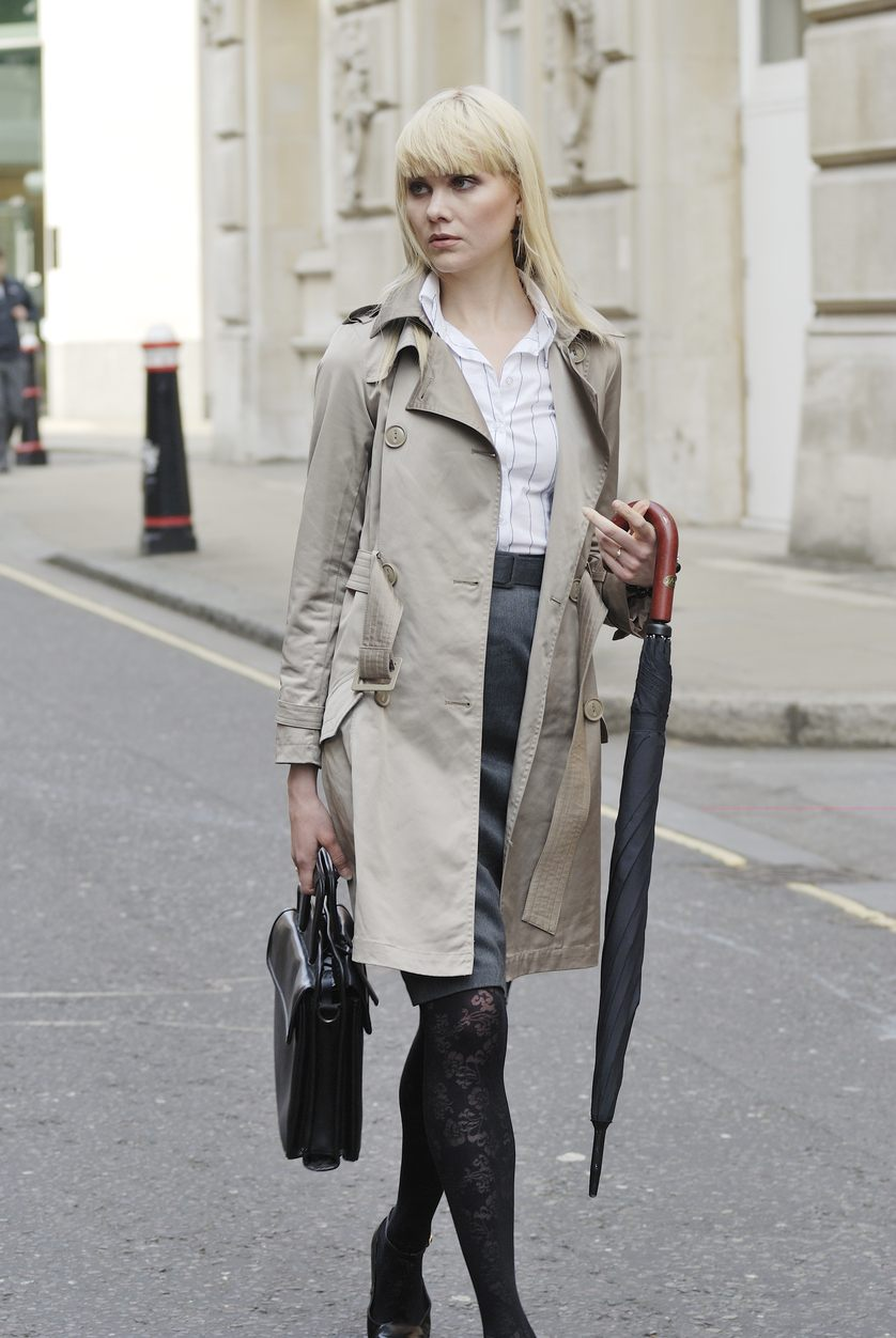 young blonde businesswoman walking down a London street