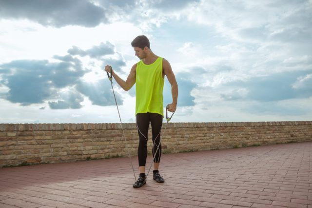 Man preparing for a workout with resistance bands