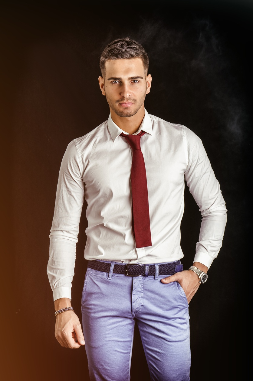 young man in in white shirt and red neck tie