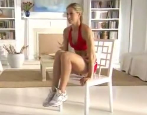 Woman demonstrates an ab exercise on a chair