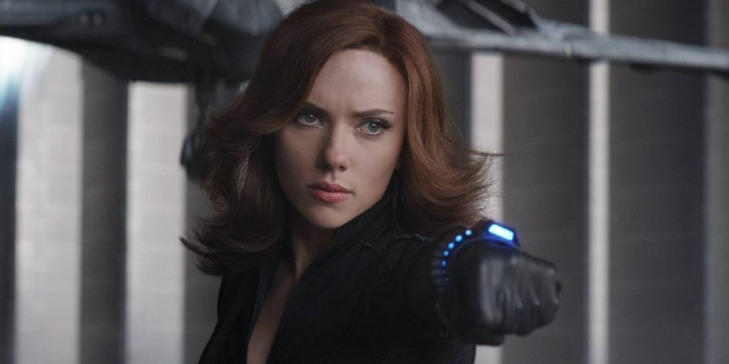 Scarlett Johansson's Black Widow points a weapon at an enemy in Avengers: Age of Ultron
