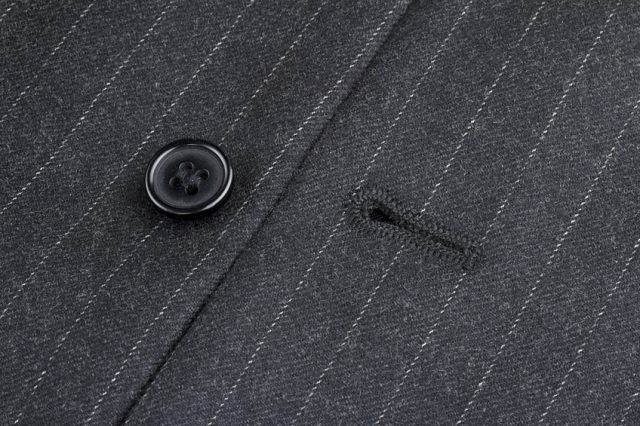 button and eyelet of a pinstriped jacket