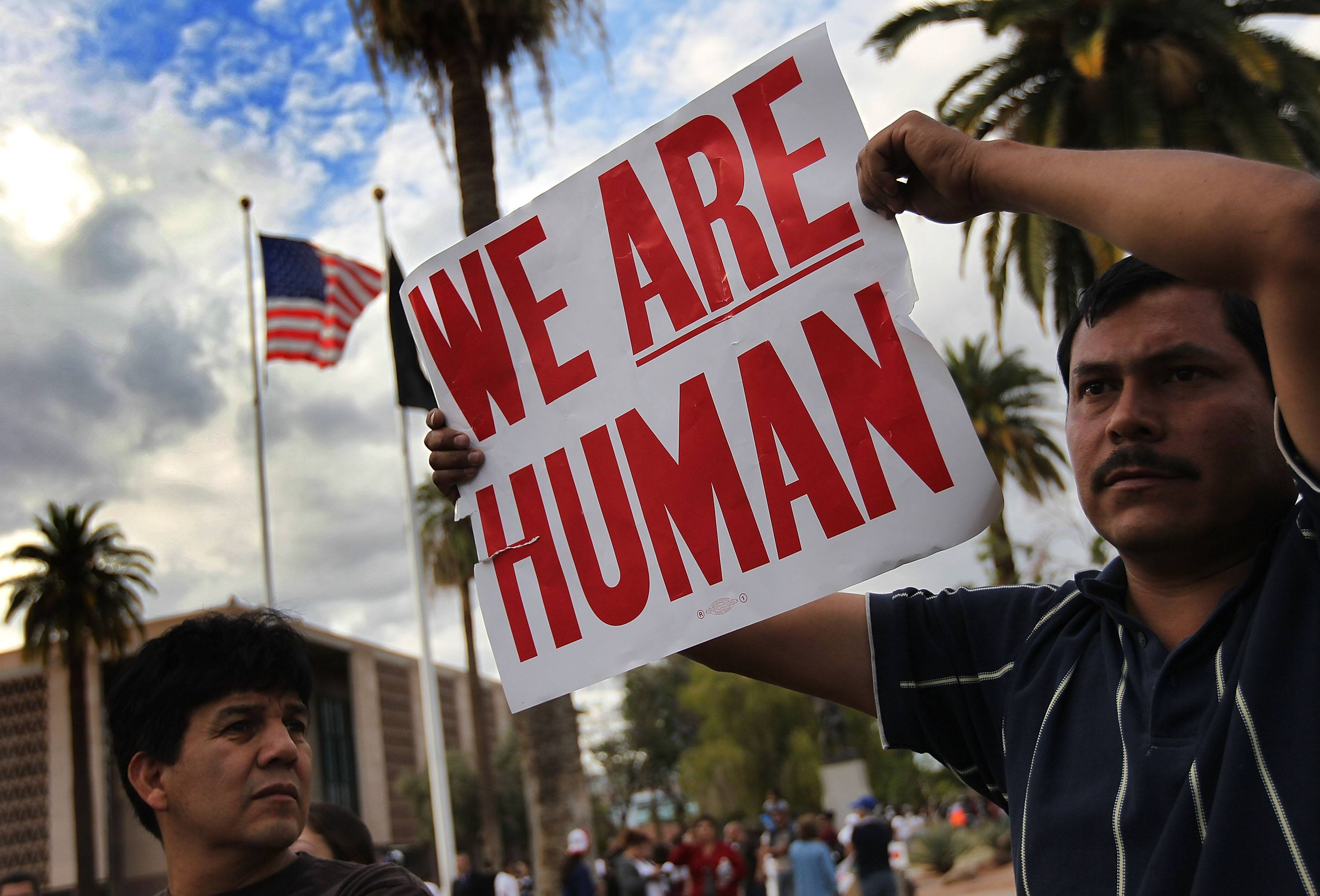 Demonstrators protest y John discrimination and discriminatory practices in Arizona