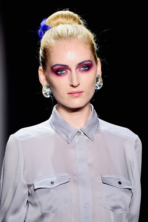 model wearing a dramatic look