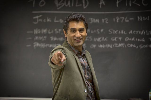 Travis (Cliff Curtis) stands in front of a blackboard in a scene from the first episode of 'Fear the Walking Dead'