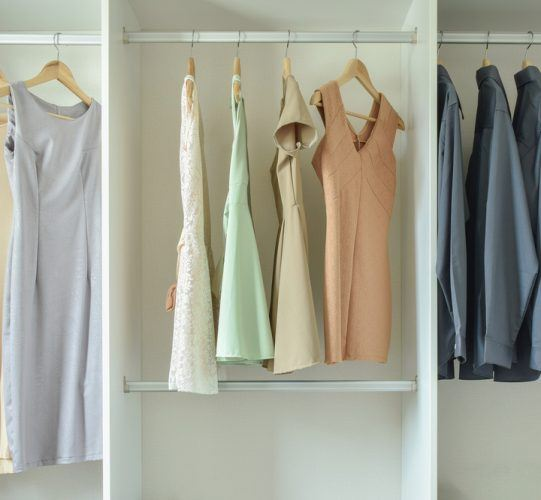 female clothes hanging on hangers