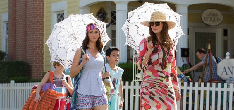 Two women outside with parasols in Gilmore Girls: A Year in the Life