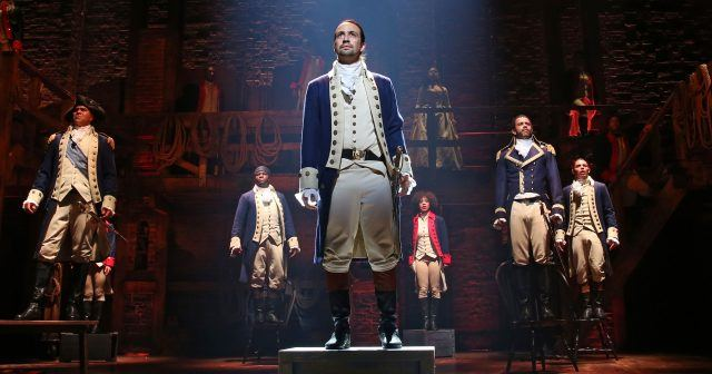 """'Hamilton's ensemble stands on chairs during """"The Battle of Yorktown."""""""