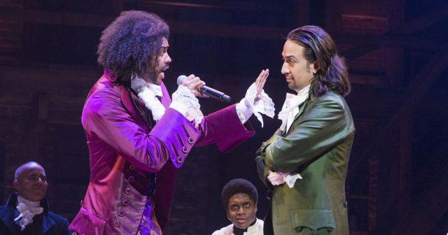 Jefferson (Daveed Diggs) and Hamilton (Lin-Manuel Miranda) engage in a rap battle in a scene from 'Hamilton'