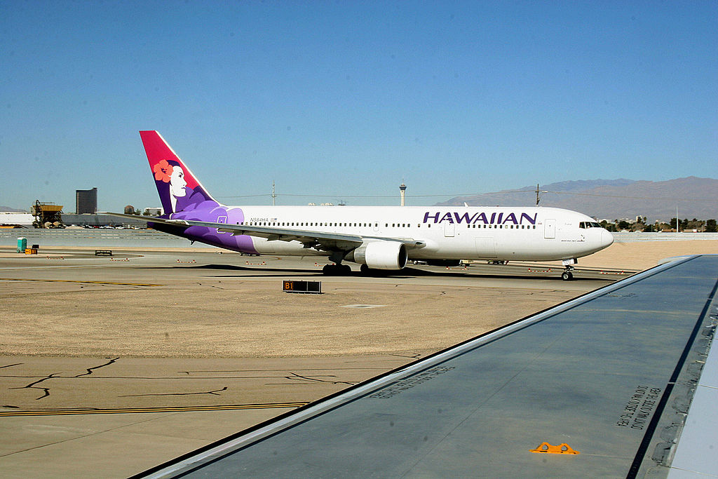 A Hawaiian Airlines jet taxies out to the runway at Phoenix Sky Harbor International Airport