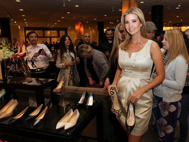 Ivanka Trump holding a pair of shoes.