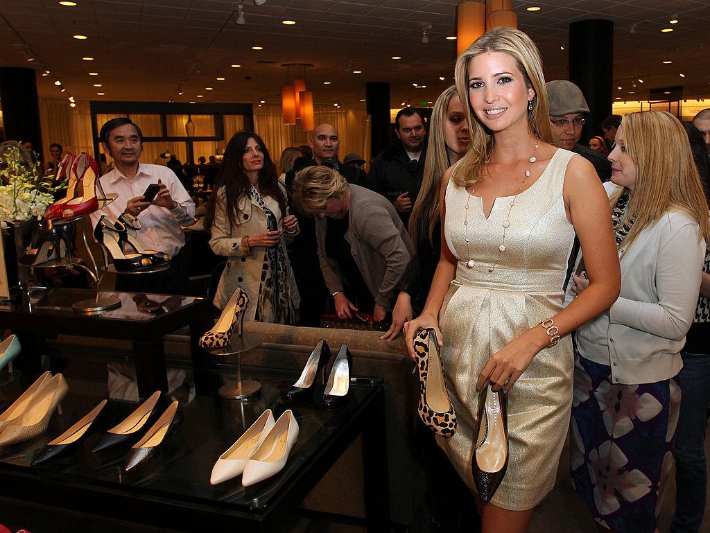 Ivanka Trump holding heels