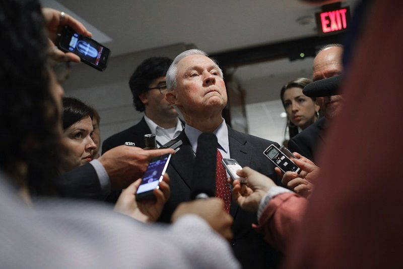 Sen. Jeff Sessions talks with reporters after a briefing