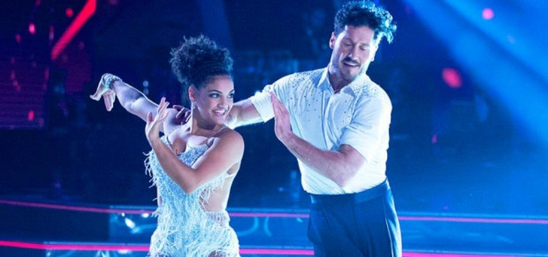 Laurie Hernadez and Maksim Chmerkovskiy dancing together on Dancing With the Stars
