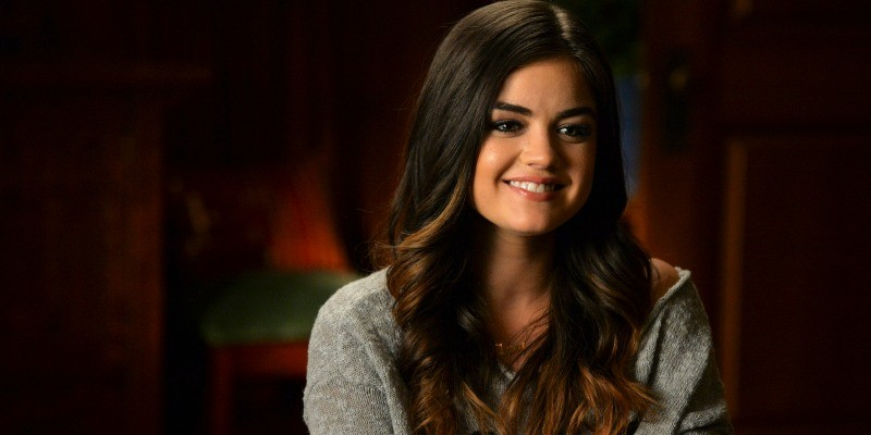 Aria is smiling in Pretty Little Liars.