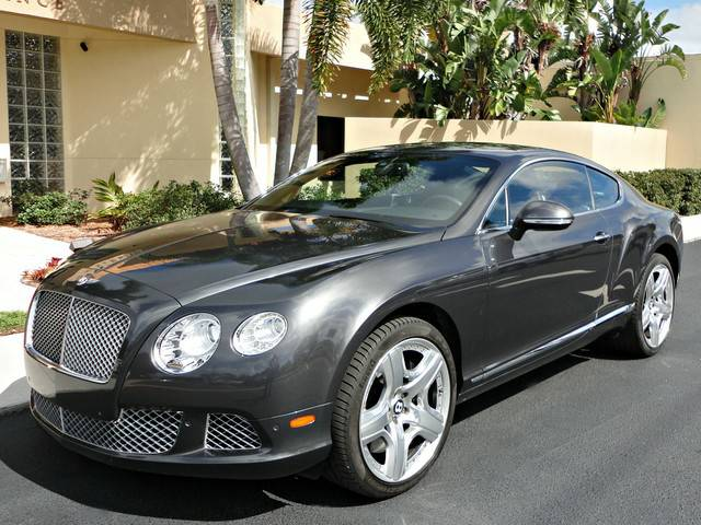 2012 Bentley Continental GT parked in front of a building.