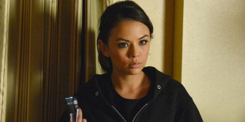 Mona is wearing a black hoodie and is looking very serious in Pretty Little Liars.