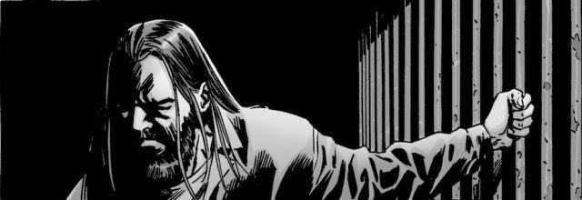 Imprisoned in Alexandria, Negan grips the bars to his prison cell in 'The Walking Dead' comics.