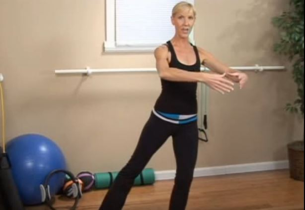 Woman demonstrates how to perform a standing lift
