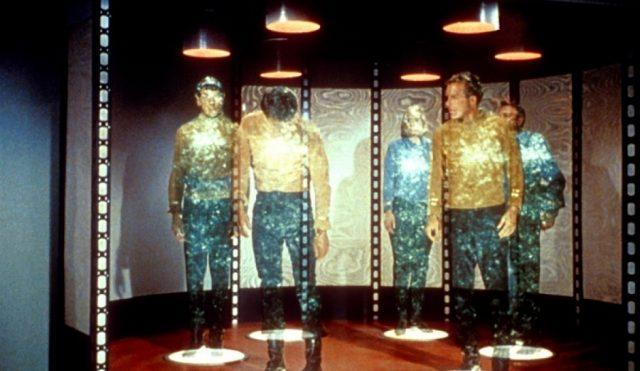 Members of the enterprise crew being beamed up in a scene from 'Star Trek'