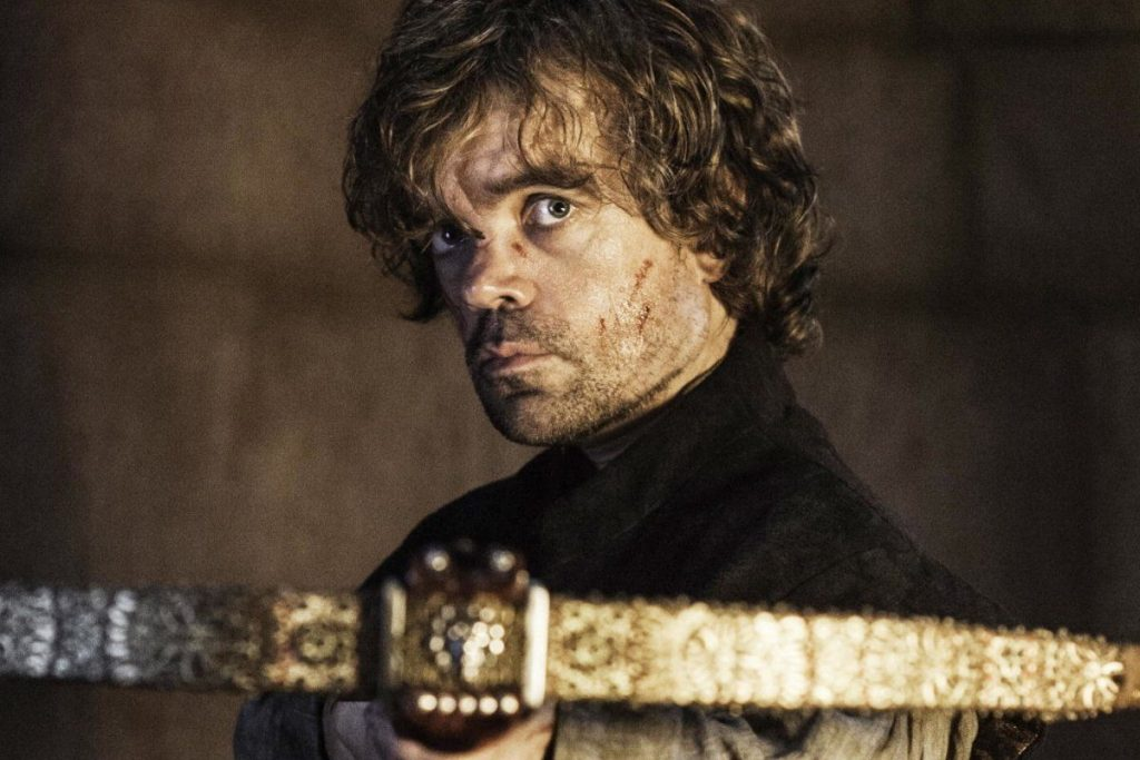 Tyrion aims a crossbow, looking directly into the camera