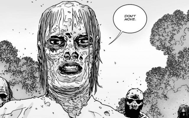 "Alpha, wearing her walker face mask, says ""Don't move"" in a scene from 'The Walking Dead' comics."