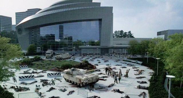 Survivors walk past dead bodies as they head toward the CDC in a scene from 'The Walking Dead'