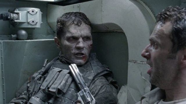 Rick Grimes (Andrew Lincoln) encounters an undead soldier in a scene from 'The Walking Dead'