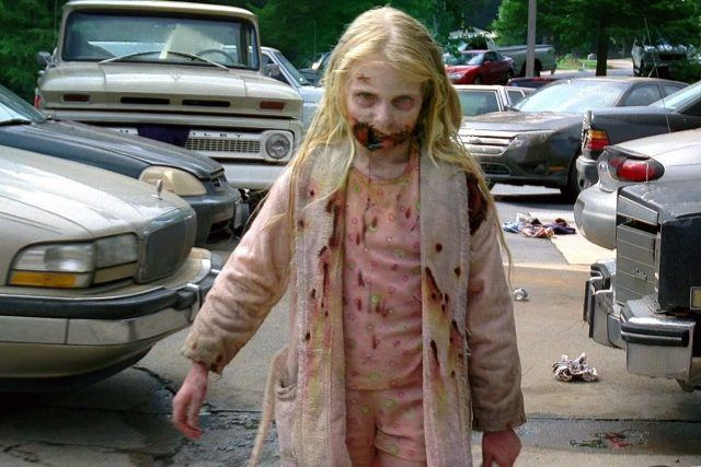 A zombie child in a pink robe from the first episode of AMC's 'The Walking Dead'